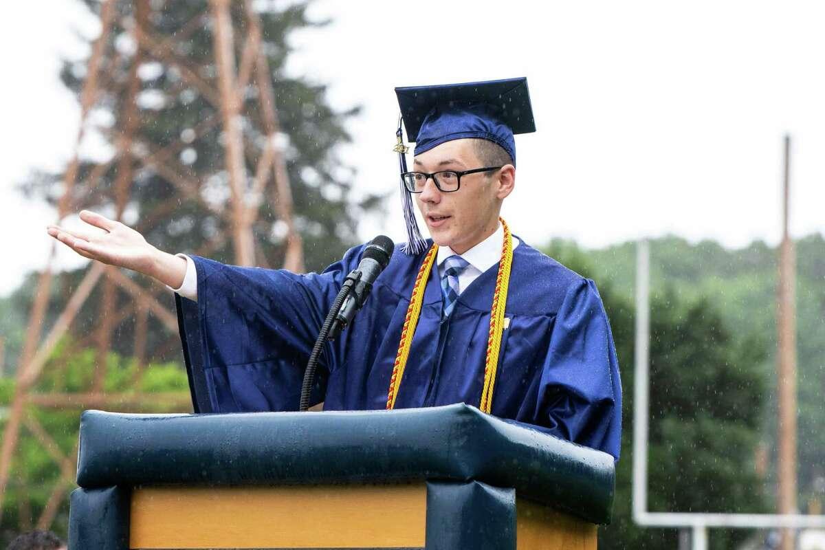 Valdictorian Michael Szewczyk address the Ansonia High School Class of 2021 during graduation exercises at Nolan Field on June 12 2021.