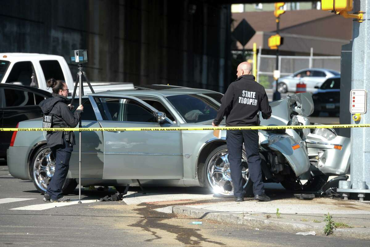 Connecticut State Police remained at the scene Wednesday morning following an overnight shooting at the intersection of Main and Catherine streets in Bridgeport on Tuesday.