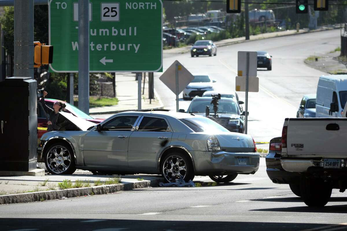 City and state policed remained at the scene Wednesday morning following an overnight shooting at the intersection of Main and Catherine streets, in Bridgeport, Conn. June 15, 2021.