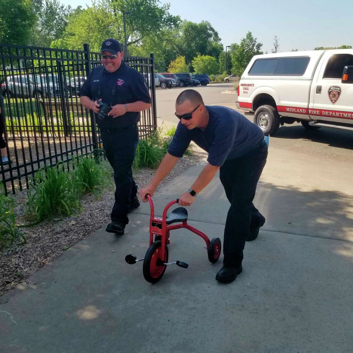 The Midland Firefighters Youth Foundation provided eight new tricycles to the Community Center for its Early Care and Education program. (Photo provided)