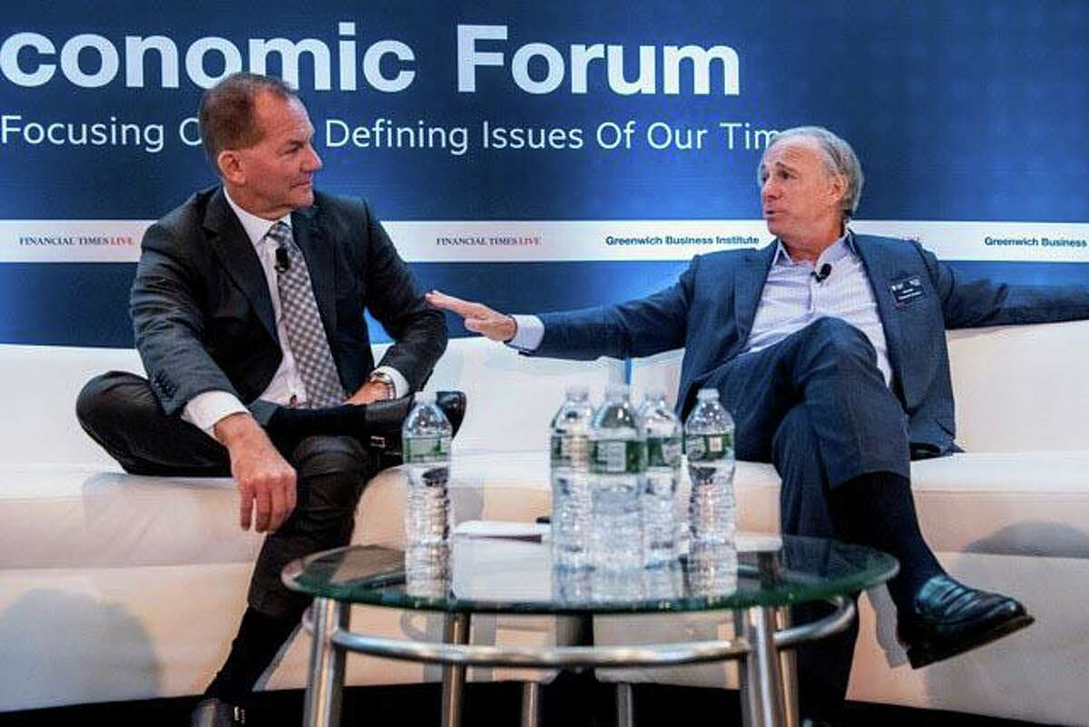 Ray Dalio, right, founder of Westport-based hedge fund Bridgewater Associates, and Paul Tudor Jones, founder of Stamford-based hedge fund Tudor Investment Corp., participate in a fireside chat at the Greenwich Economic Forum conference at the Greenwich Delamar hotel on Nov. 5, 2019. The 2021 GEF conference will be held Sept. 21-23, with events on Sept. 21 at the Greenwich Delamar.