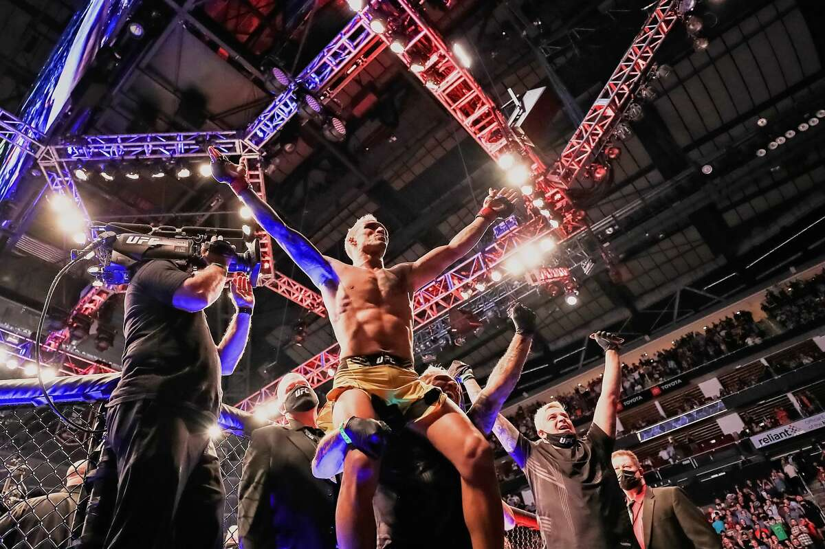 Charles Oliveira celebrates defeating Michael Chandler during their Championship Lightweight Bout of UFC 262 at Toyota Center on May 15, 2021 in Houston. (Photo by Carmen Mandato/Getty Images)