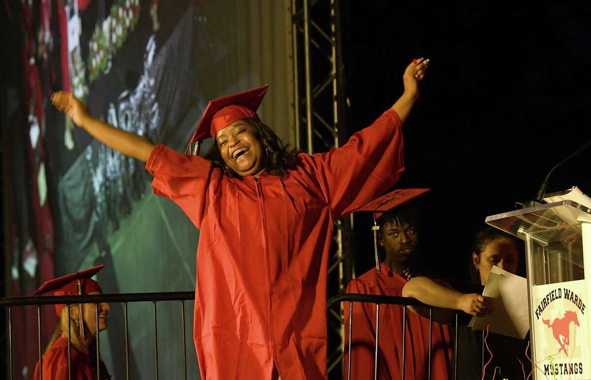 Rinaya Roc expresses her joy just before receiving her diploma. Fairfield Warde High School holds its graduation ceremony at Jennings Beach in Fairfield, Tuesday evening, June 15, 2021.
