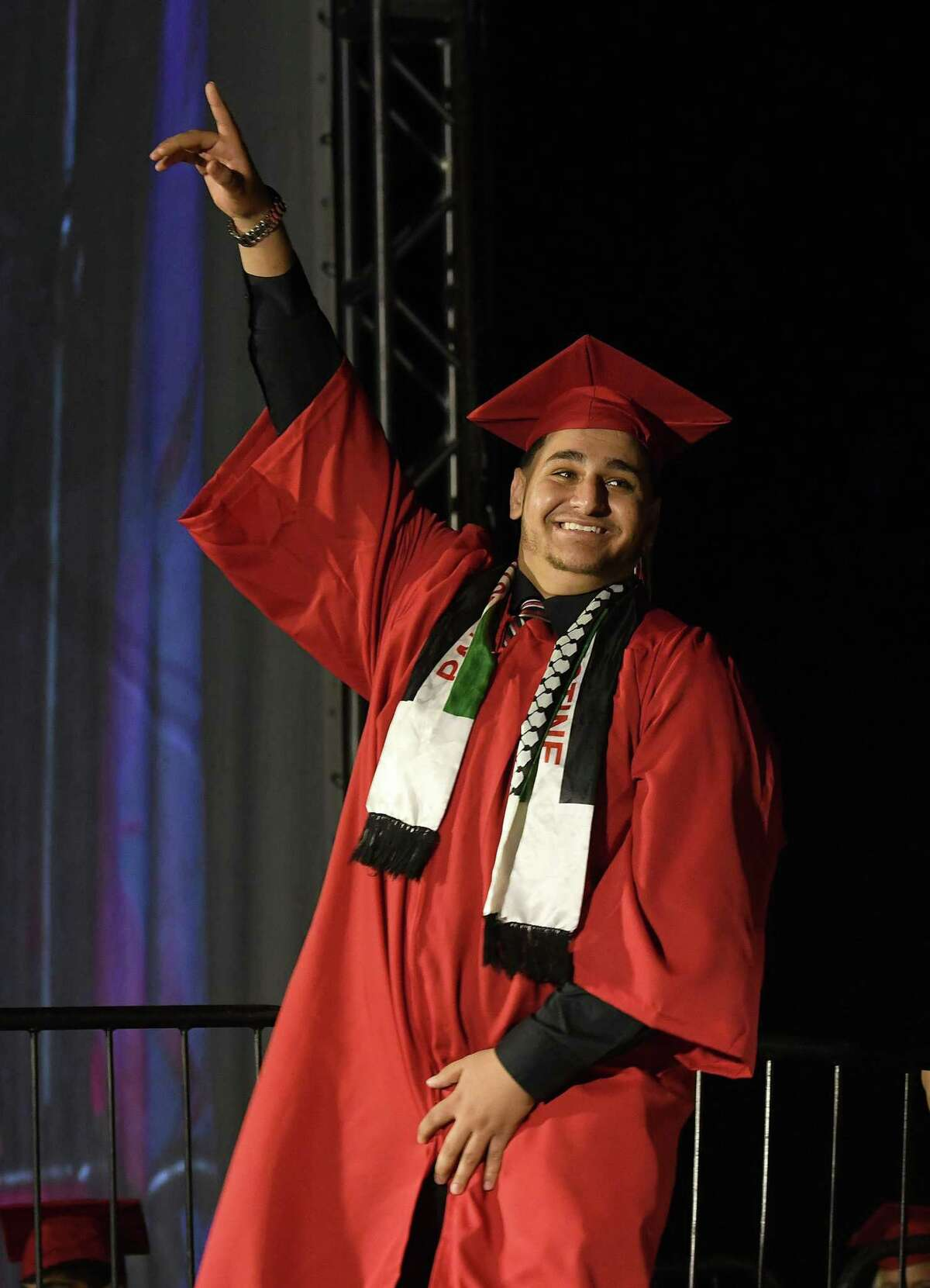 Mohammad Shaham, 18, just before receiving his high school diploma. Fairfield Warde High School holds its graduation ceremony at Jennings Beach in Fairfield, Tuesday evening, June 15, 2021.