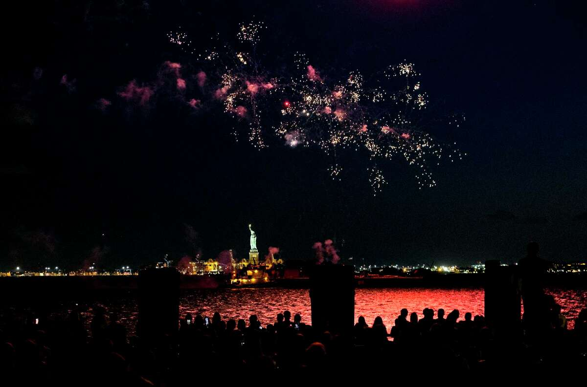 Fireworks explode over New York Harbor and the Statue of Liberty as New York and other cities around New York state recognize a rate of 70% for single dose vaccinations against the COVID-19 virus, Tuesday, June 15, 2021 in New York. Celebration of the milestone was announced by Gov. Andrew Cuomo earlier in the day.