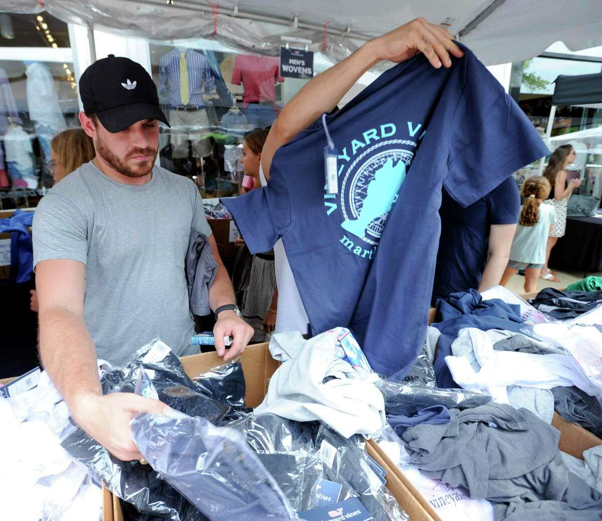 Austin West of Dallas hunts for a bargain at Vineyard Vines as he shops local retailers during the Chamber of Commerce Sidewalk Sales Day in Greenwich, Conn. on July 11, 2019.