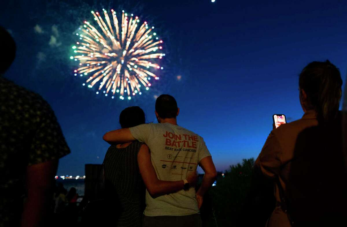 People watch as fireworks explode over New York Harbor as New York and other cities around New York state recognize a rate of 70% for single dose vaccinations against the COVID-19 virus, Tuesday, June 15, 2021 in New York. Celebration of the milestone was announced by Gov. Andrew Cuomo earlier in the day.