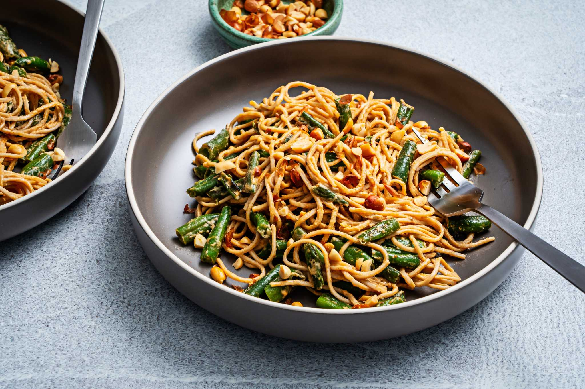 Spicy peanut noodles are a quick, pantry-friendly meal that's ready for riffing