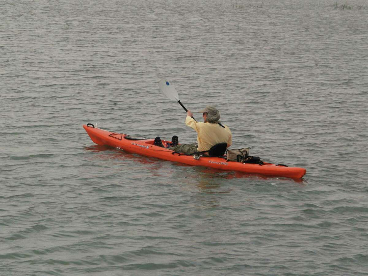 This kayaker is making his way toward a spot to fish on Copano Bay.