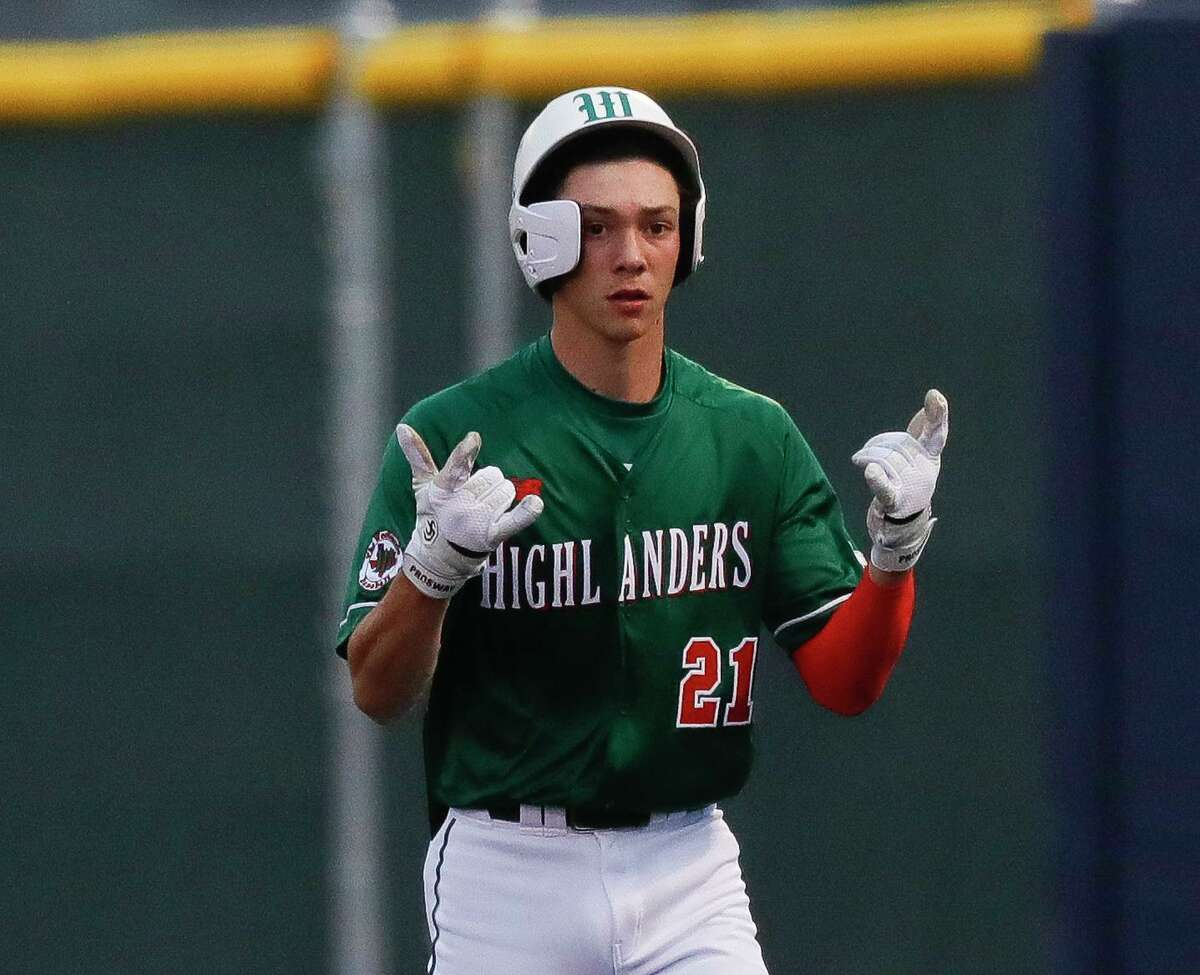 Brayden Sharp #21 of The Woodlands gestures after beating the throw to first during the third inning of a Region II-6A high school baseball area playoff game at Cypress Ranch High School, Thursday, May 13, 2021, in Cypress.