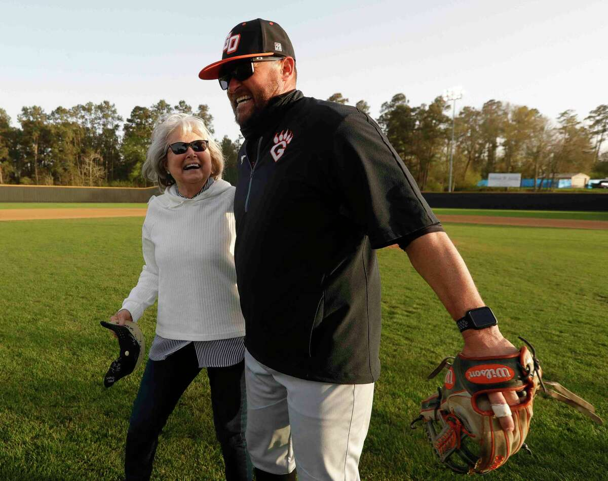 Annette Ferrell shares a moment with her son, Lou, after throwing out the first pitch before a District 13-6A high school baseball game at Conroe High School, Wednesday, March 17, 2021, in Conroe. The Conroe Tigers honored Annette's huband and longtime coach Mike Ferrell before the game. Ferrell, who lead the Tigers for 33 years, died last August.