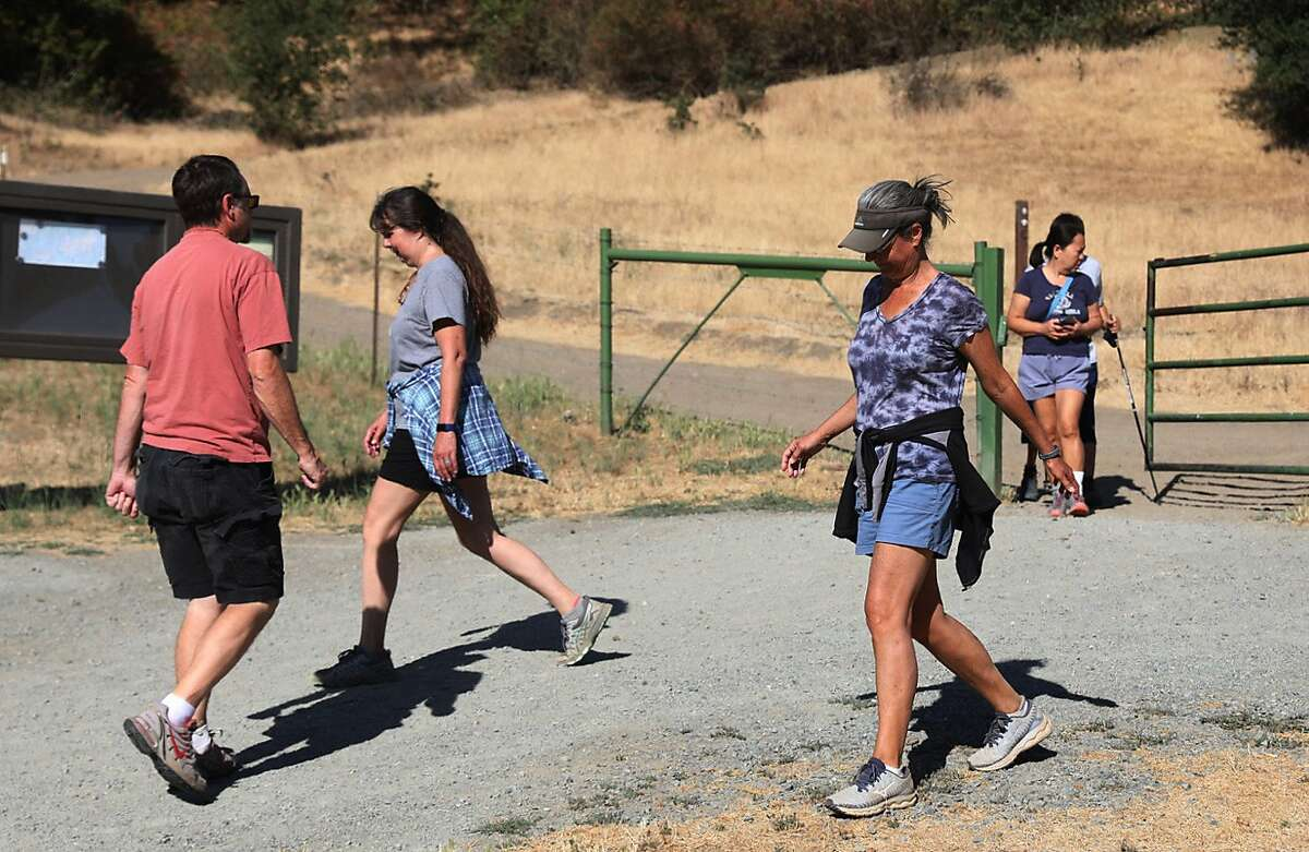 Hikers prepare for a workout at the park. Temperatures as high as 110 could grip Pleasanton and other East Bay cities.