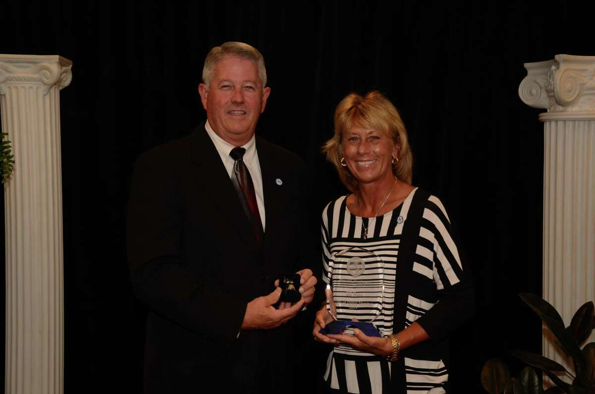 Debbie Fuchs, retiring Clear Creek Director of Athletics, is shown with former Clear Creek AD Bill Daws at the Texas High School Athletic Directors Association 2014 state conference and banquet.