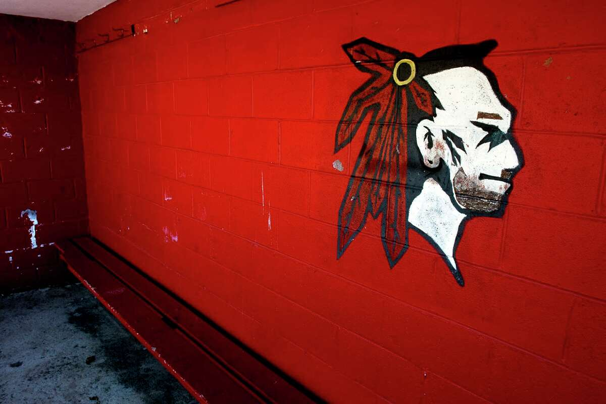 The Red Raiders logo, mascot for Derby High School, painted inside the dugout of the baseball field in Derby in 2018.