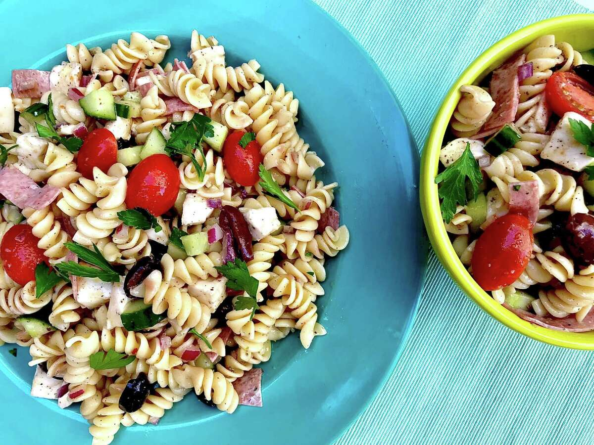 Easiest Pasta Salad recipe from thekitchn. combines pasta with chopped cucumbers, tomatoes, olives, mozzarella and salami.