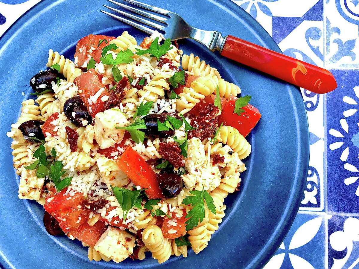 Tomato Feta Pasta Salad from Ina Garten combines ripe tomatoes, sundried tomatoes, kalamata olives and feta.