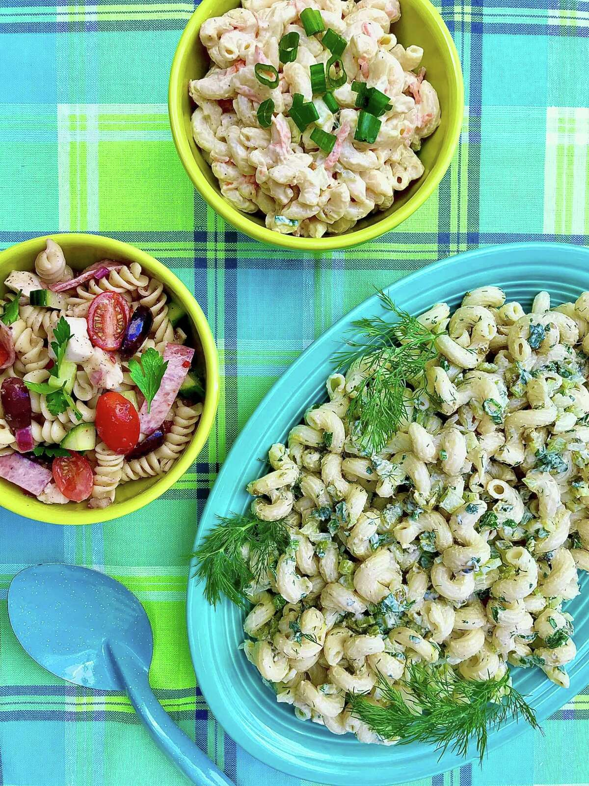 Macaroni and pasta salads clockwise from top, Hawaiian Macaroni Salad, Macaroni Salad with Lemon and Herbs, and Easiest Pasta Salad.
