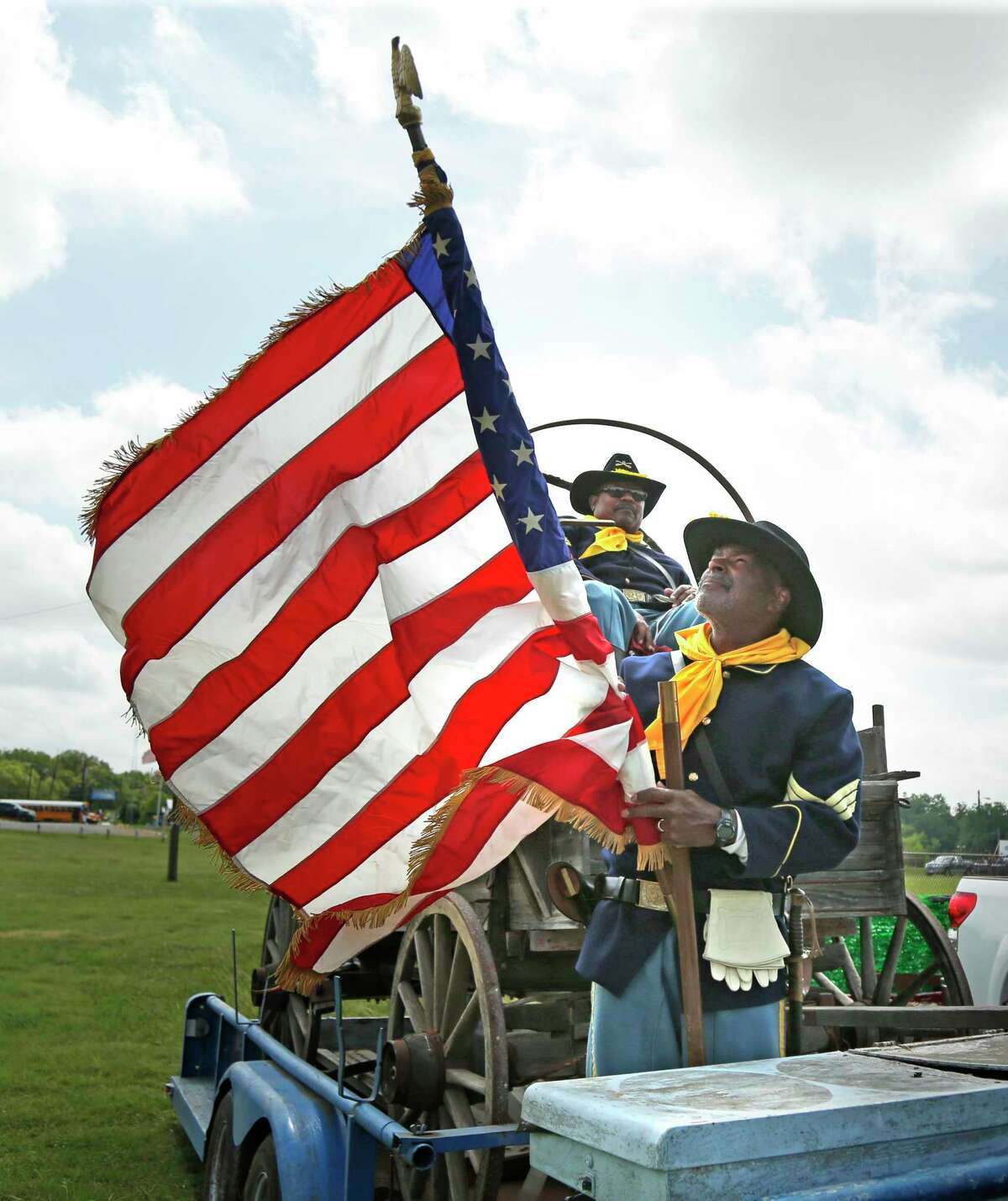 Trooper Jerry Cheaton folds the flag after he and the Buffalo Soldiers marched in the parade to Comanche Park during the 2019 Texas Freedom Festival.
