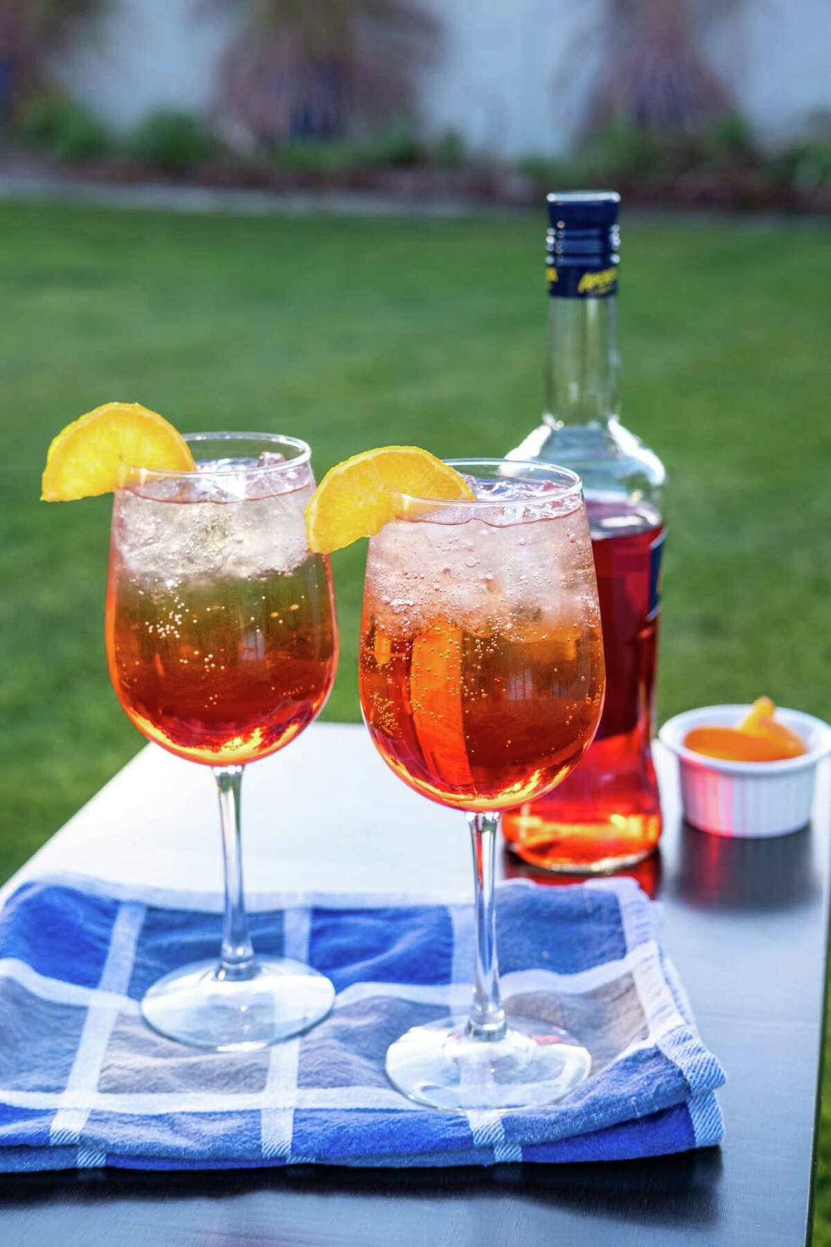 """The Aperol Spritz from """"The Hard Seltzer Cocktail Book: 55 Unofficial Recipes for White Claw Slushies, Truly Mixers, and More Spiked-Seltzer Drinks"""" (Ulysses Press) by Casie Vogel."""
