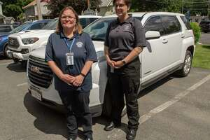 Katie Flanigan, clinical director of emergency services and training, left, and Nena Ruiz, paramedic supervisor, stand next to the unmarked vehicle used for the new Albany County Crisis Officials Responding and Diverting (ACCORD) program at the Voorheesville EMS station on Wednesday, June 16, 2021 in Voorheesville N.Y. This pilot program is a response to the growing calls for mental health professionals to respond to mental health crises in an effort to avoid police escalation and violence. (Lori Van Buren/Times Union)
