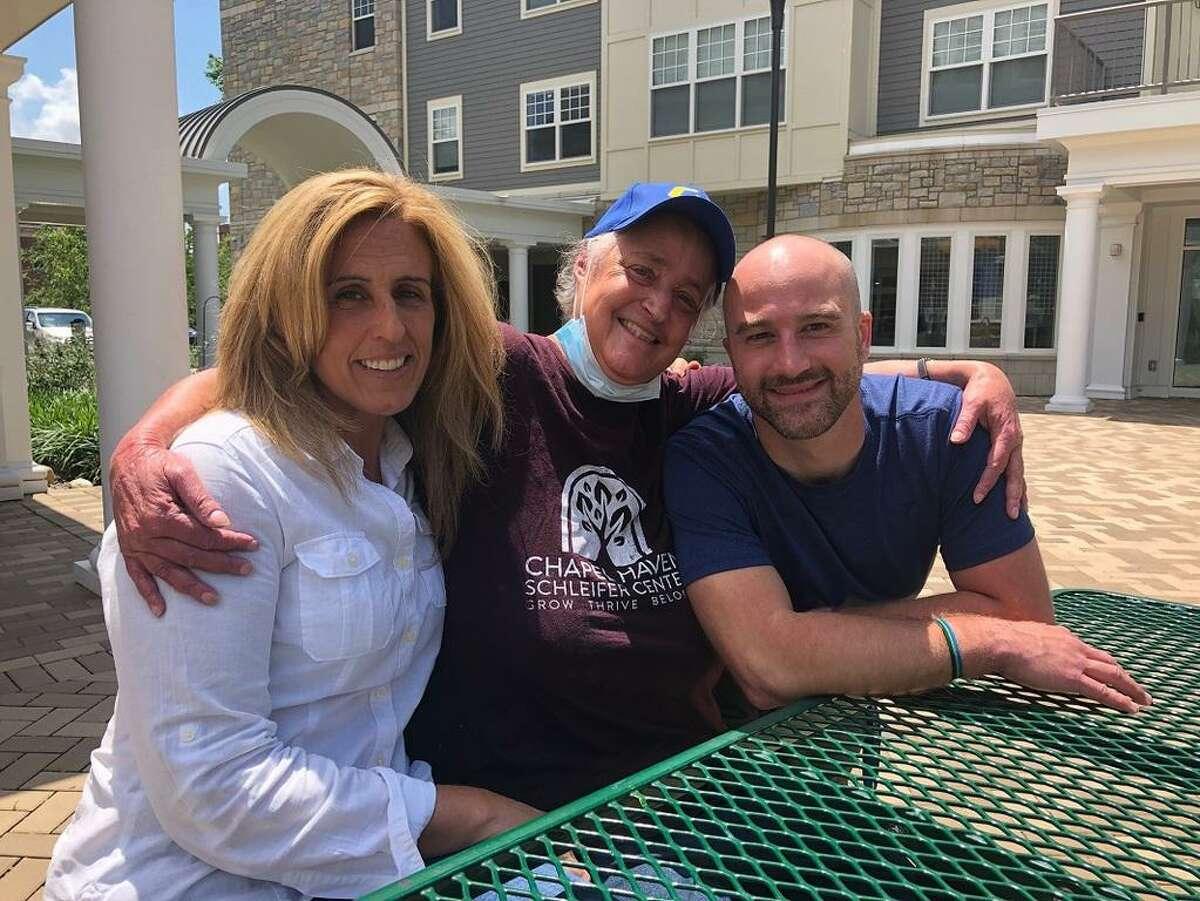 From left, Chapel Haven staffer Sunny Richards, resident Shawn Feldman and staffer Adam Ursone. The two staffers saved Feldman's life when she was choking.