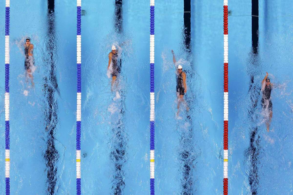 OMAHA, NEBRASKA - JUNE 14: Katharine Berkoff, Rhyan White, Catie Deloof and Lucie Nordmann of the United States compete in a preliminary heat for the Women's 100m backstroke during Day Two of the 2021 U.S. Olympic Team Swimming Trials at CHI Health Center on June 14, 2021 in Omaha, Nebraska. (Photo by Al Bello/Getty Images)