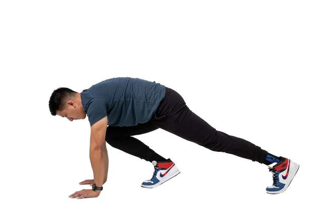 Pull your right knee into your chest as far as you can reach; switch legs by pushing one knee out and pulling the other in.