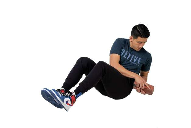Use your abdominal muscles to twist to the right, back to center and then to the left. If you don't want to use extra weight, clasp your hands together. Photo: Godofredo A. Vásquez, Houston Chronicle / Staff Photographer / © 2021 Houston Chronicle