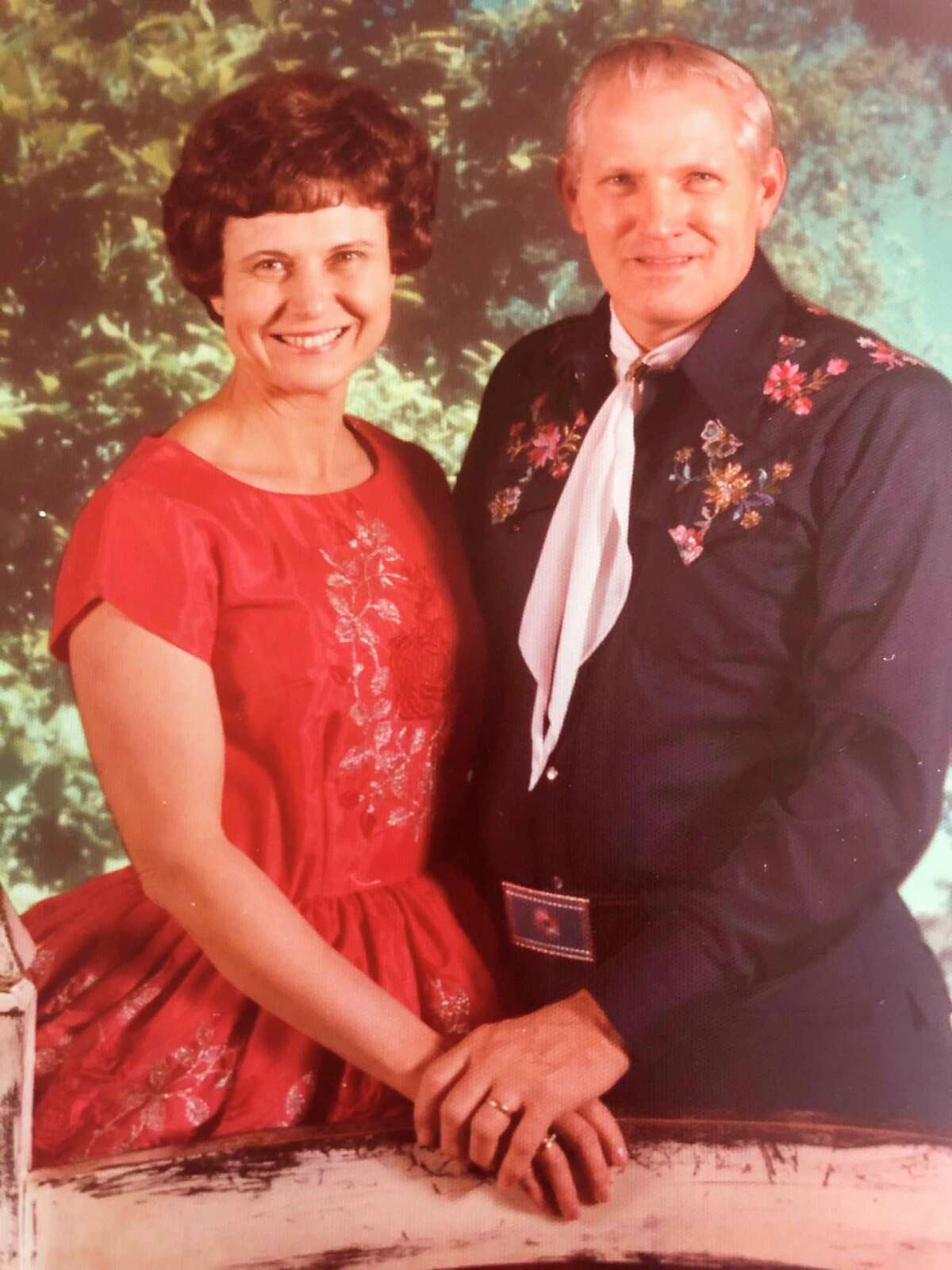 """Leona and Wilbur Seamster are photographed at a square dance convention. From 1978 to 1982, they were assistant chairmen for the 1982 National Square Dance Convention to be held in Detroit at Cobo Hall. Leona said: """"For the next four years, we traveled and danced all over the United States promoting Michigan's 1982 convention."""" Their efforts were rewarded with 25,000 enthusiastic square dancers filling Cobo Hall in June 1982. (Photo provided)"""