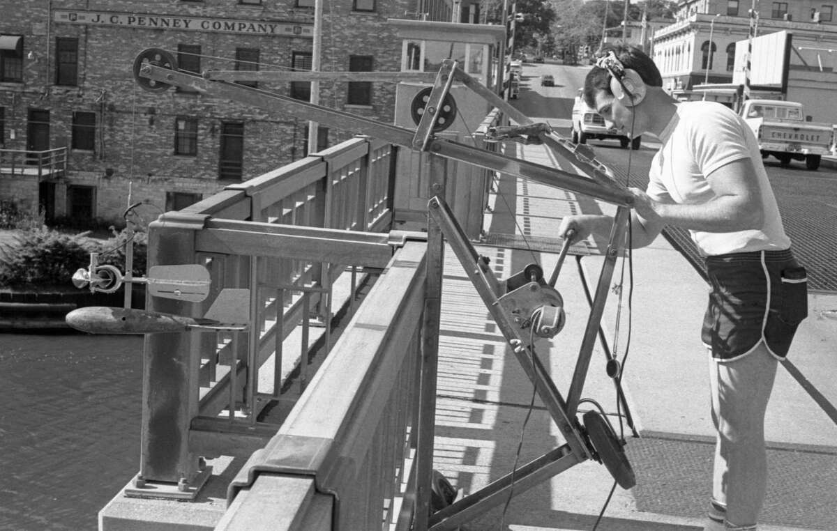 The fellow with the odd-looking apparatus seen on the Maple Street Bridge this morning was Don James of the United States Geological Survey Service, who was taking the monthly water flow measurement and water sampling from the river. The photo was published in the News Advocate on June 17, 1981. (Manistee County Historical Museum photo)