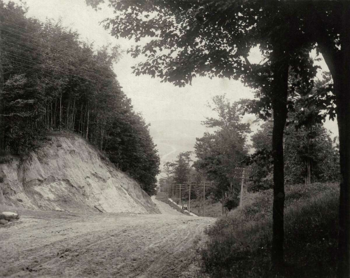 The Beulah/Benzonia hill about 1920, showing the cut made to lessen the steepness, although good brakes still a necessity. (Courtesy photo)