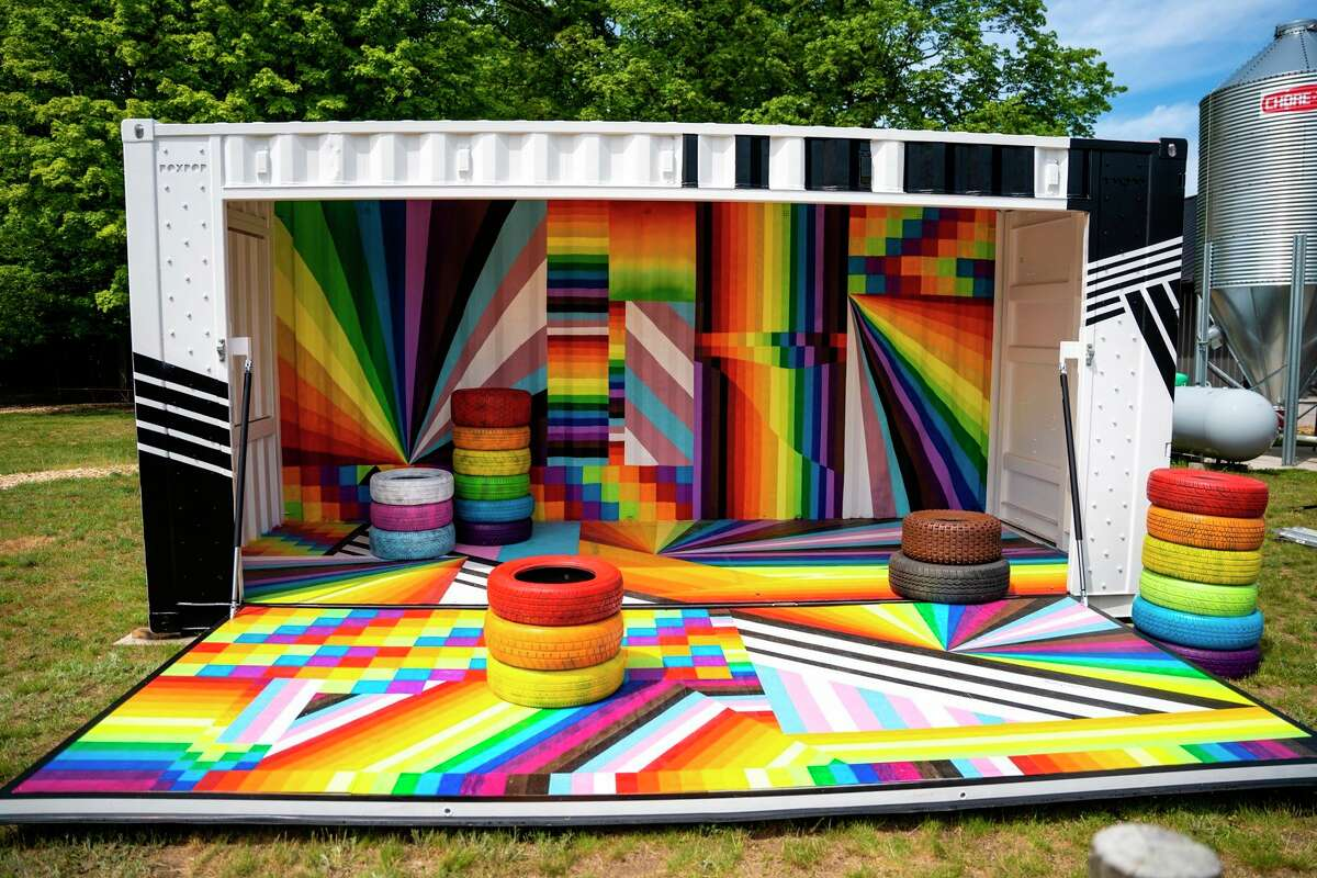 A brightly painted Britten BoxPop shipping container is on display at Iron Fish Distillery as part of three pride art installations for Pride Month. (Courtesy Photo)