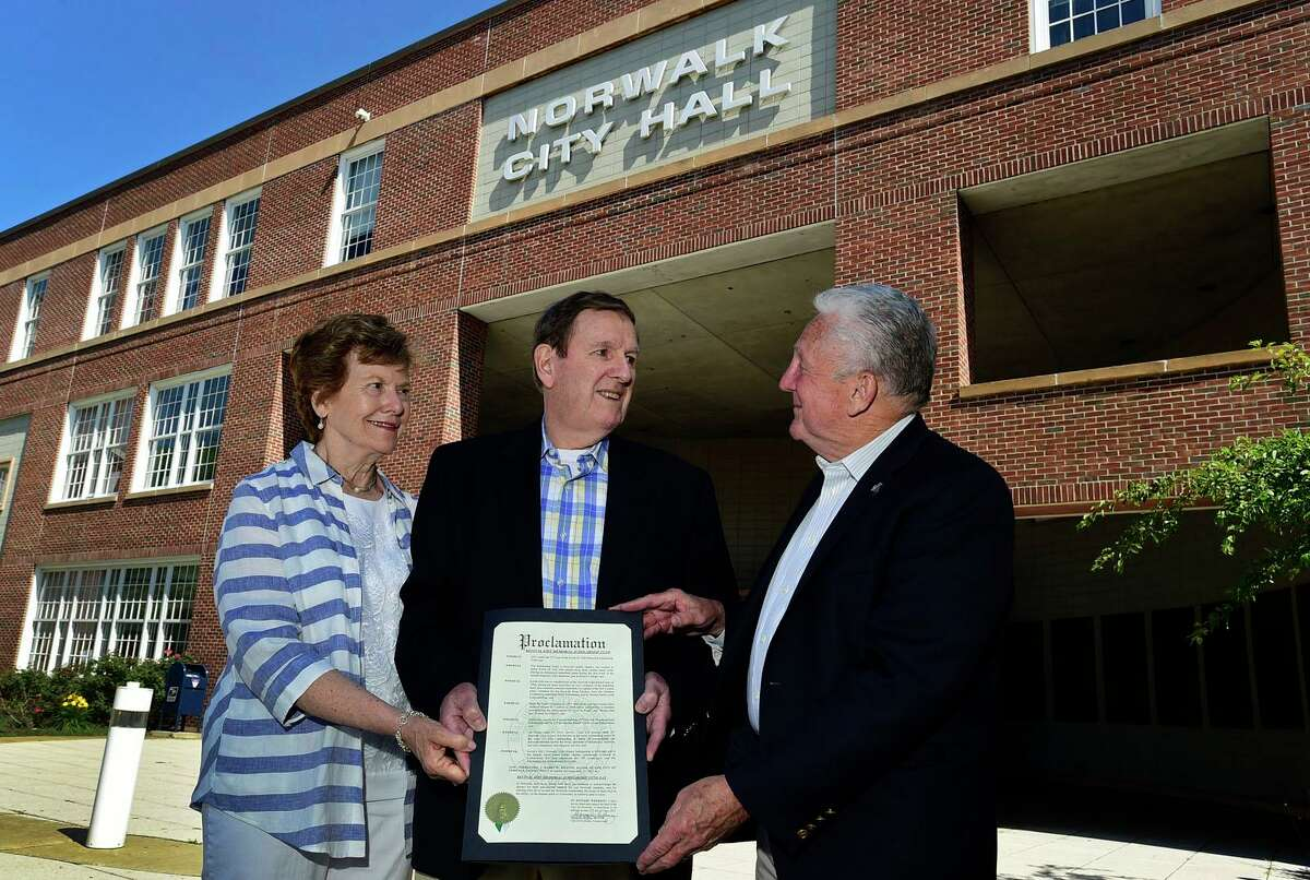 Kevin Eidt's parents, Christian and Helen Eidt, who founded a scholarship in the name of their late son, listen as Norwalk Mayor Harry Rilling proclaims June 25 as Kevin Eidt Day in front of city hall Wednesday, June 16, 2021, in Norwalk, Conn.