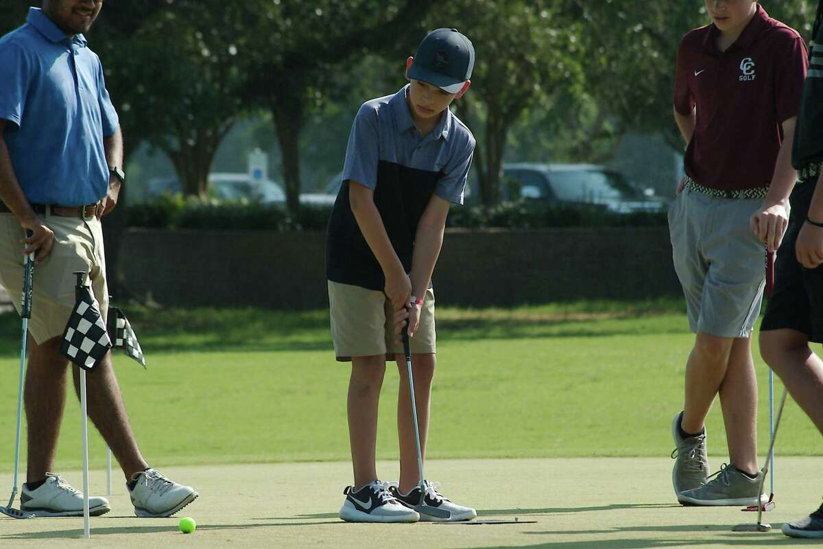 Gabriel Guerrero practices his putting skills at the Wildcat Golf Camp held at South Shore Harbor Country Club in League City.