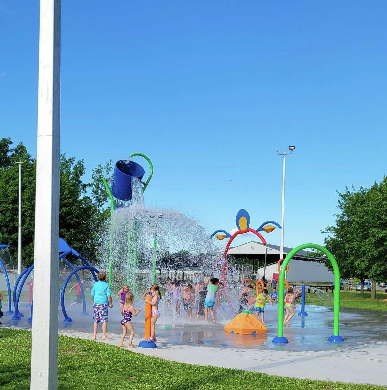 "Children play in the Caro splash pad at the ""AquaZone"" grand opening June 14 in Bieth Memorial Park. (Courtesy Photo)"