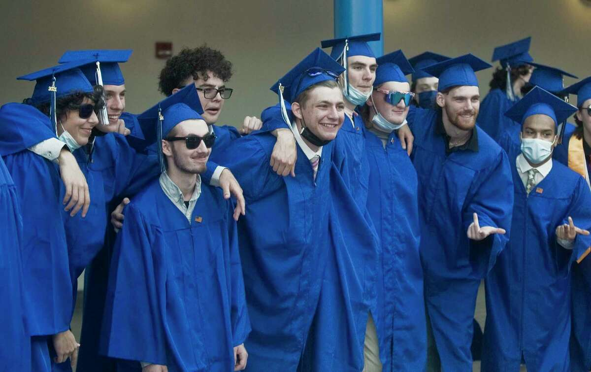 Grads posing for a picture at the Henry Abbott Technical High School graduation. Wednesday, June 16, 2021