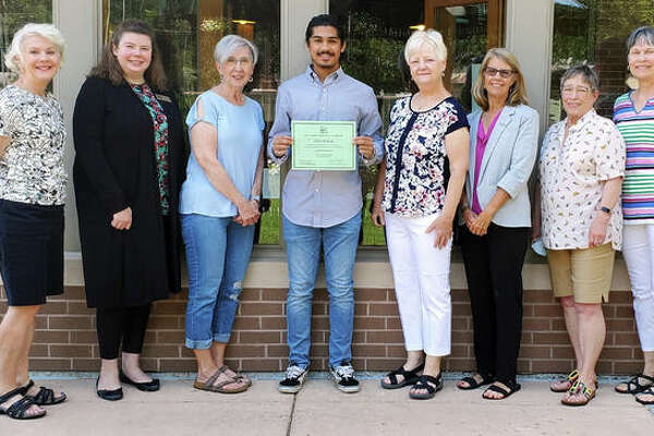 Ghazwan Khan is this year's recipient of a $500 scholarship from the Glen Carbon Friends of the Library. He is planning to attend SIUE in the fall and eventually wants to study law. Ghazwan is a past volunteer at the library. (From left to right) Susan Jernigan, Christine Gerrish, Ann Poehling, Ghazwan Khan, Nona Kelley, Andrea Pekkarinen, Pat Davis and Jan Johnson.