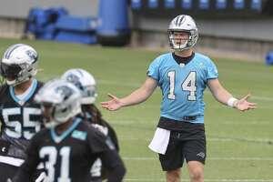 Carolina Panthers quarterback Sam Darnold gestures during NFL football practice in Charlotte, N.C., Wednesday, June 2, 2021.