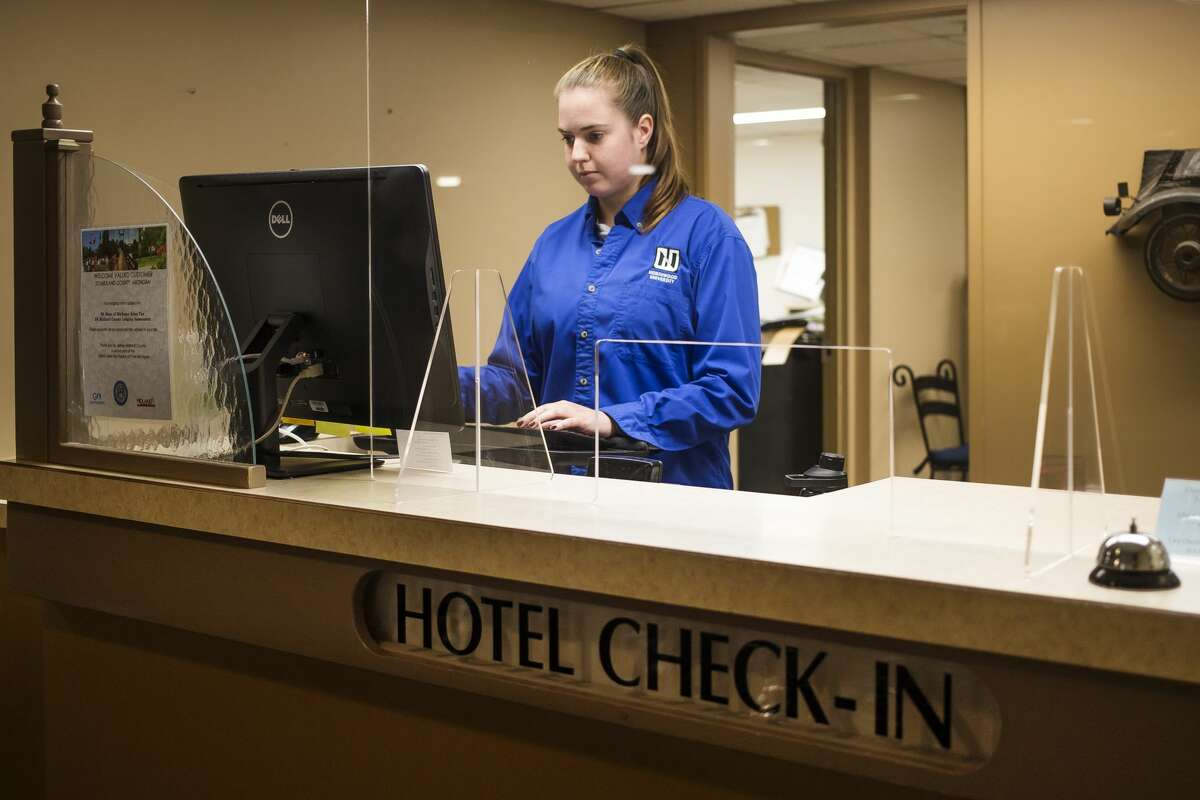 Iryna Trystan, a hospitality management student at Northwood University, staffs the front desk at the N.A.D.A. Hotel & Conference Center Wednesday, June 16, 2021 on the Northwood campus in Midland. (Katy Kildee/kkildee@mdn.net)