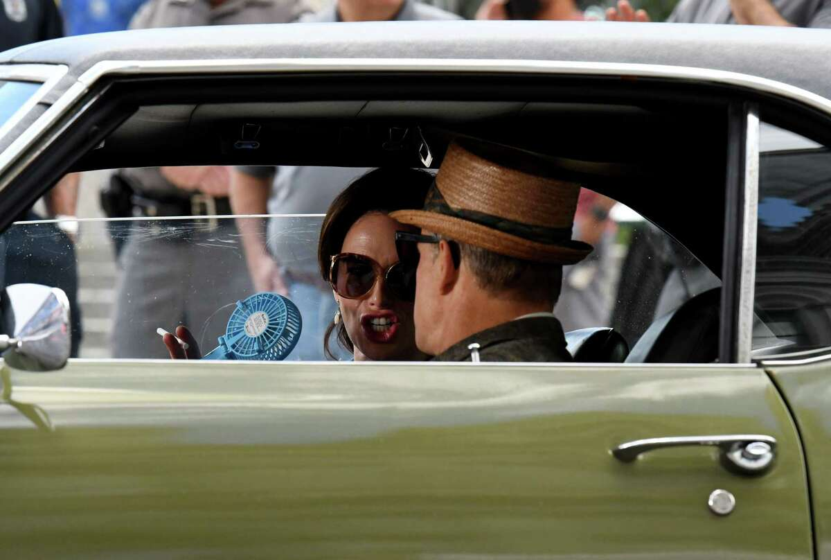 Actors Woody Harrelson and Lena Headey prepare shoot a scene for HBO's 'The White House Plumbers' on Wednesday, June 16, 2021, outside the Capitol on State Street in Albany, N.Y. The series chronicles the story of the Watergate masterminds. (Will Waldron/Times Union)