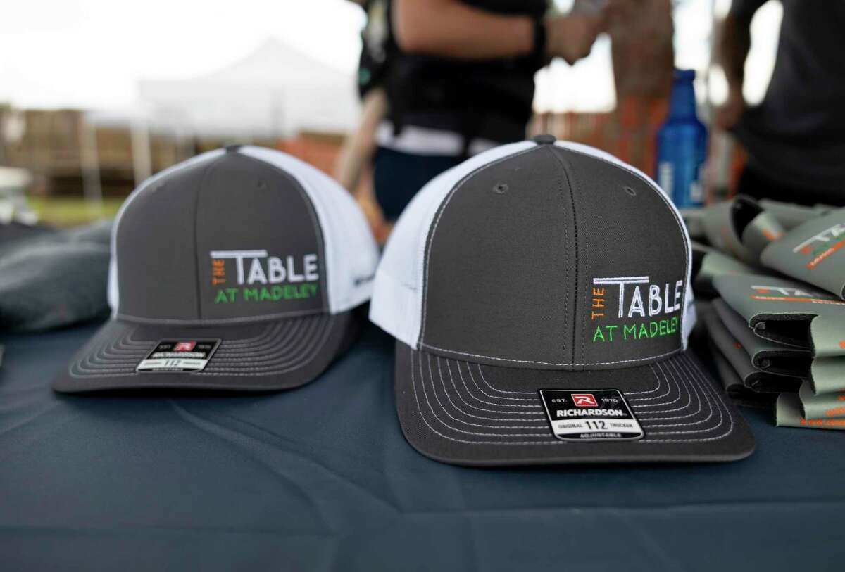 Custom hats are seen during a groundbreaking event at the future location of The Table at the Madeley, Tuesday, June 15, 2021, in Conroe. The new facility plans to to open up at the beginning of 2022.