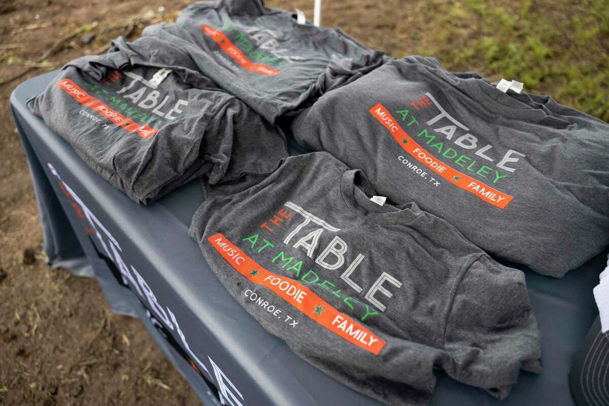 Custom t-shirts are seen during a groundbreaking event at the future location of The Table at the Madeley, Tuesday, June 15, 2021, in Conroe. The new facility plans to to open up at the beginning of 2022.