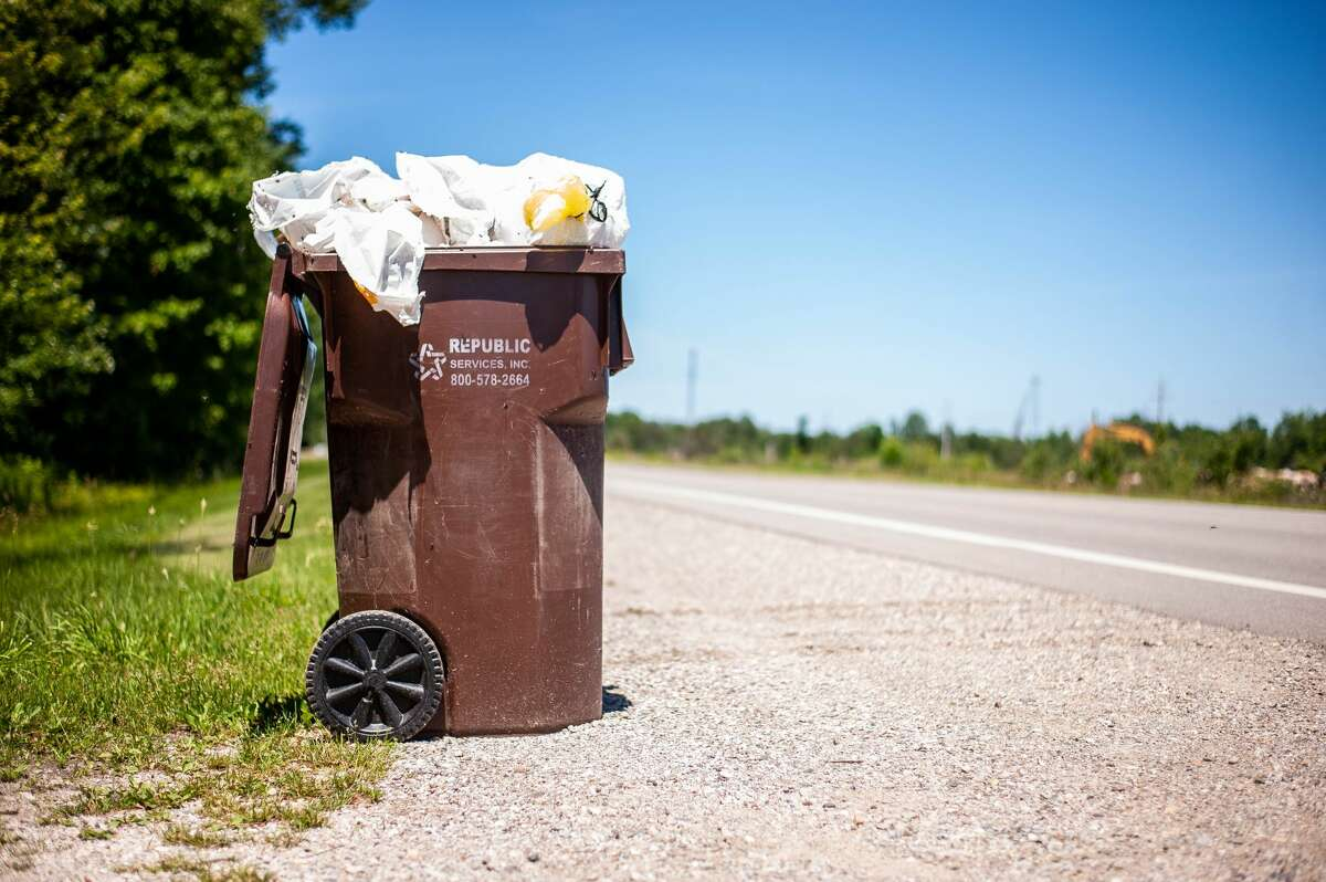 An overflowing trash can sits near Beaverton on June 16, 2021.