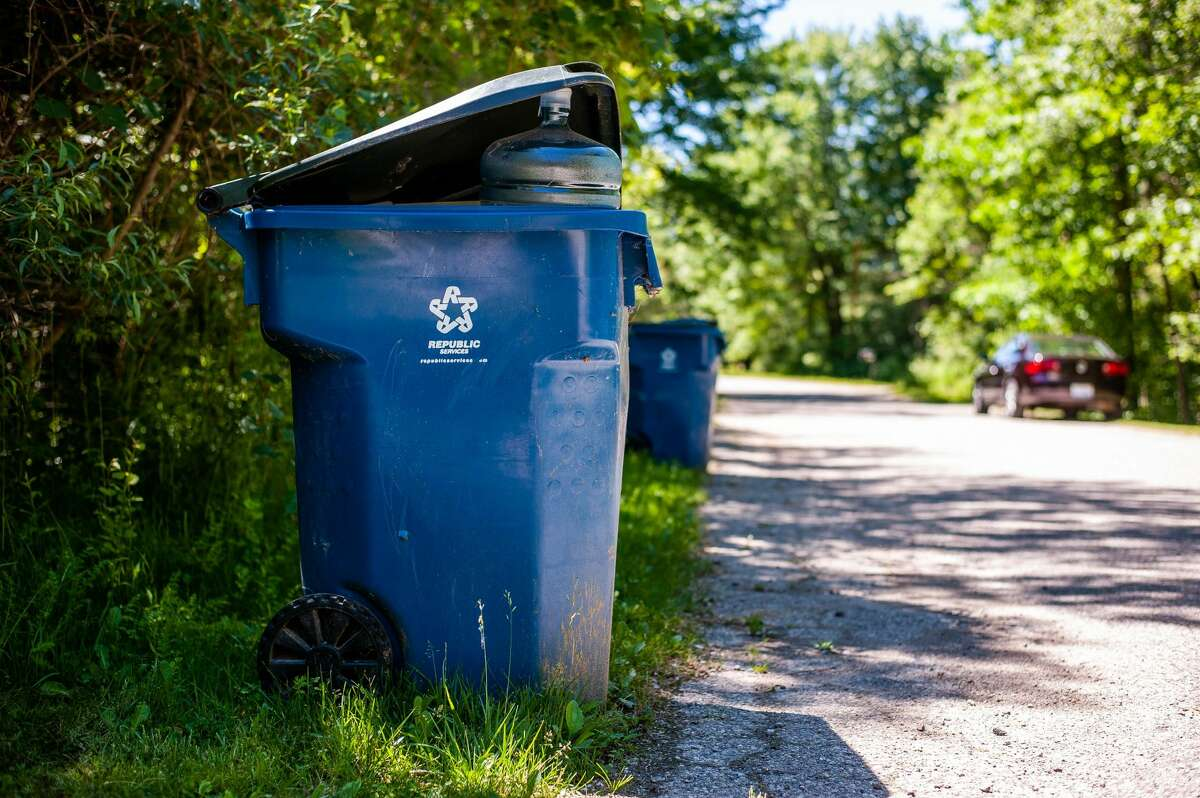 A recycling bin sits on North Keen Court in Mills Township, June 16, 2021. Republic Services picked up recycling bins on the court the next day.
