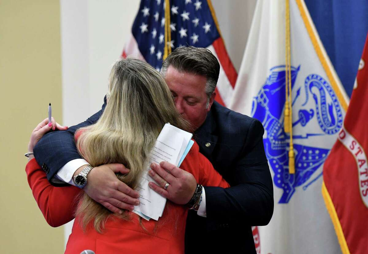 Albany County Executive Dan McCoy embraces County Health Commissioner Dr. Elizabeth Whalen following the final county COVID-19 briefing on Wednesday, June 16, 2021, at the county offices in Albany, N.Y. (Will Waldron/Times Union)