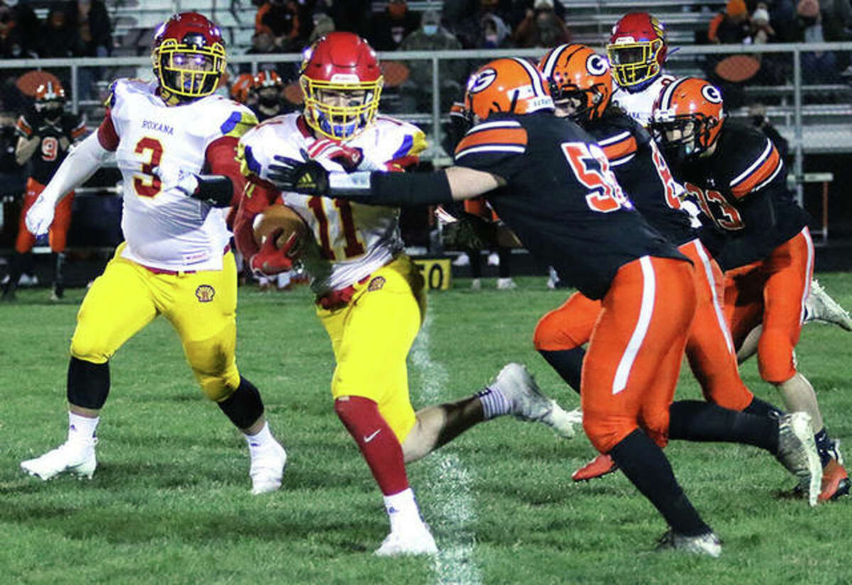 Roxana's Braeden Wells (11) pulls away from Gillespie tacklers for a big gain while the Shells's Christian Floyd (3) looks to make a block in a 2021 game in Gillespie. Wells has been chosen to play in the Illinois High School Shrine Football Game Saturday in Bloomington.
