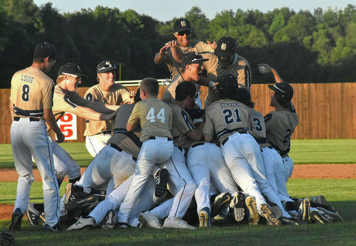 The Father McGivney Griffins celebrate after defeating Camp Point Central on Monday to advance to the Class 1A state tournament.