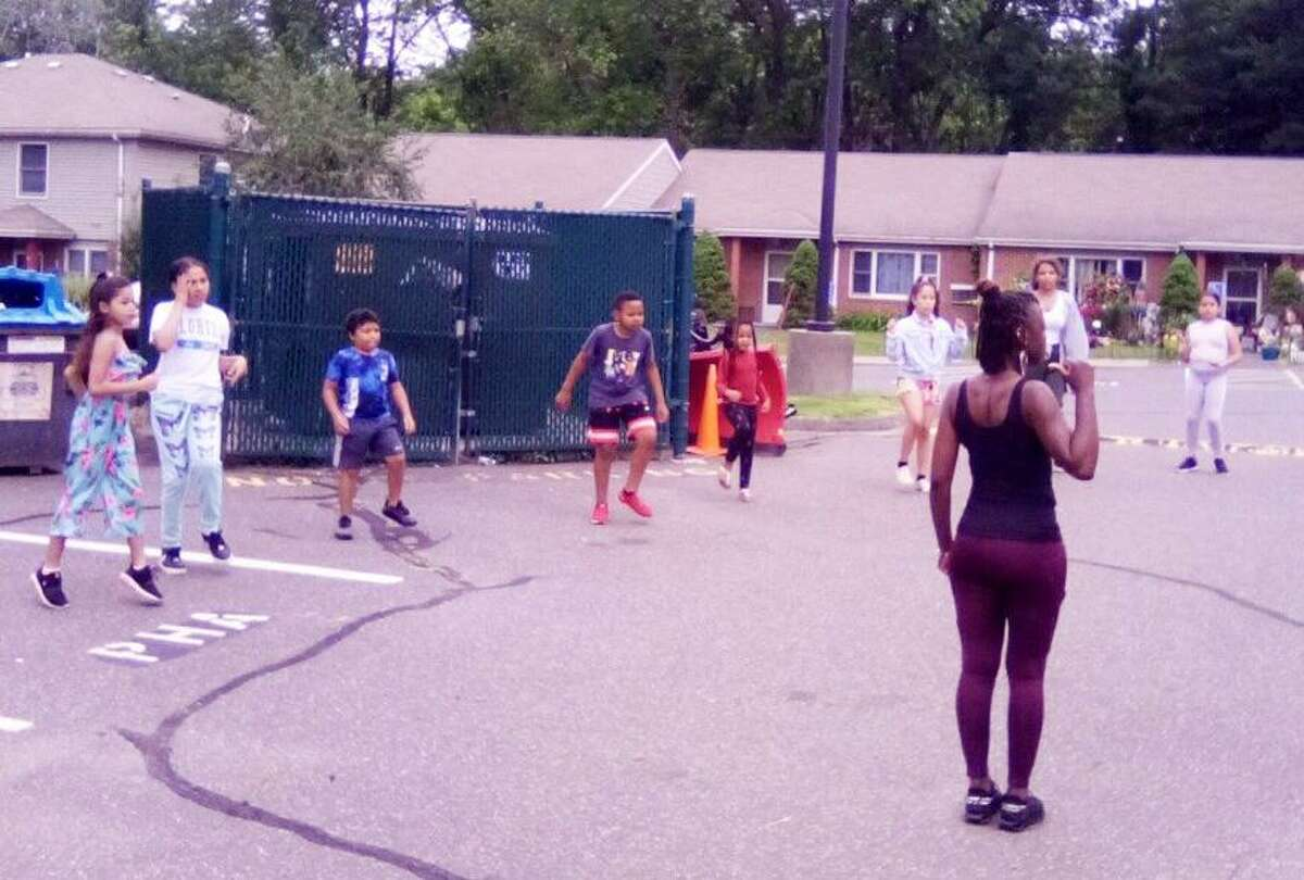 """Shanay Fulton and Tanjah Thompson of Middletown are leading """"Summer Saturdays,"""" an afternoon youth dance troupe at the Chatham Court housing project in Portland. The effort, funded by a $1,500 Portland Youth Services grant, is administered by Oddfellows Youth Playhouse in Middletown."""