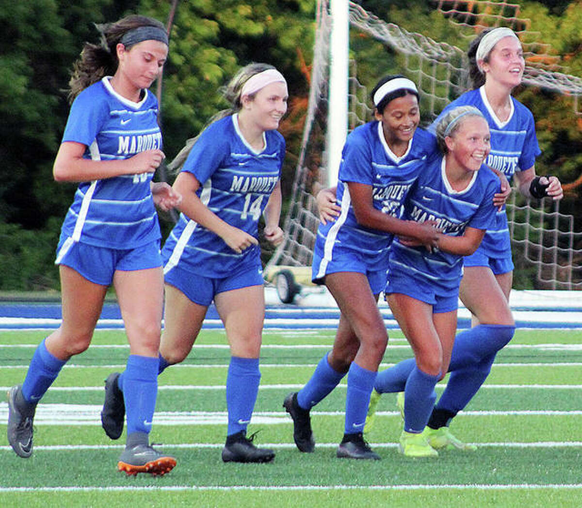 Marquette players, from left, Ellie Jacobs , Lydia Randazzo, Aela Scruggs, Clare Antrainer and Jillian Nelson celebrate a goal during Tuesday night's Class 1A Girls Super-Sectional soccer game against Belleville Althoff at Columbia High School.