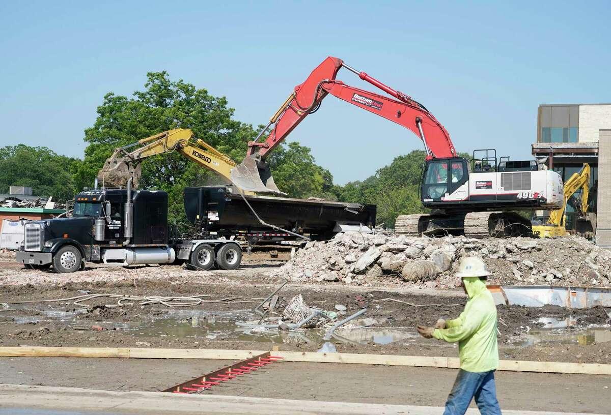 Demolition crews work at Landrum Middle School, 2200 Ridgecrest Dr., Wednesday, June 16, 2021 in Houston. Workers began demolishing the 65-year-old Spring Branch ISD school on Wednesday.
